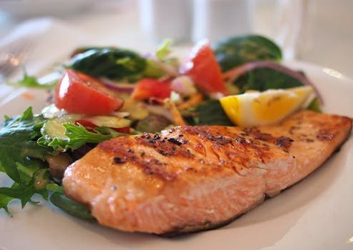 salmon and salad on white plate